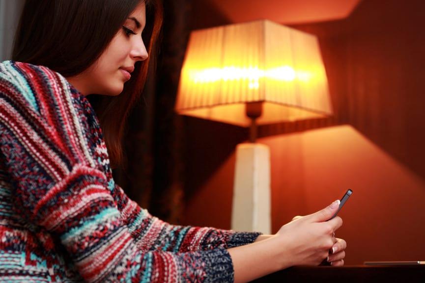 Portrait of a beautiful woman using smartphone